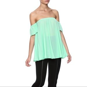 Million Bullpup Off The Shoulder Flowy Blouse